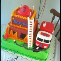 "Firetruck Cake Firetruck cake for a little boy that loves ""woo woos"". Firetruck is shaped out of pound cake, building is chocolate cake and..."