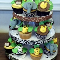 Safari Themed Baby Shower Cupcakes Mom to be wanted a safari themed baby shower. Handmade fondant safari animals on top of chocolate, vanilla and lemon cupcakes. They were a...
