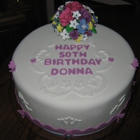 Donna's 50Th B-Day Cake Vanilla cake, with lemon filling. Sugar Paste flowers.
