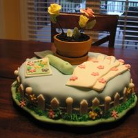 Gardening Fondant covered cake with gumpaste accessories (spade, seed packet, etc).