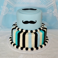 Mustache Baby Shower Cake fondant and buttercream. i freehand cut all the mustaches.