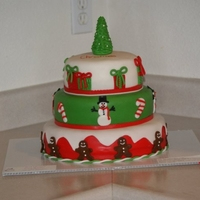 Our First Christmas Cake Christmas tree, presents, candy canes and gingerbread men