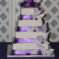 Our 2Nd Wedding Cake   4tierd square cake with purple ribbon and butterflies