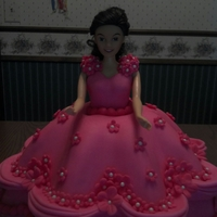 My Birthday Cake Barbie doll cake. Dark Chocolate with buttercream filling and hot pink fondant decorations.