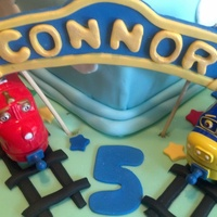"Chuggington Cake for my grandson's fifth birthday. I started making fondant trains when I found out from him he wanted ""real trains""...."