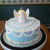 90Th Birthday Cake   Fondant angel, blue fondant with buttercream accents. Pink fondant flowers.