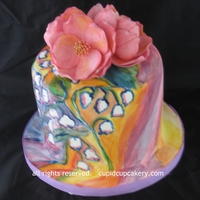 Watercolor Lily Of The Valley Cake This was a birthday cake for 3 people, 18, 21 and 80. I was asked for colorful, unusual and lily of the valley flowers. The gumpaste...