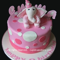 Pink Elephant Birthday Cake This was a simple last-minute cake made for a little girl's birthday. Her mom had me make a little pink elephant that looked like her...