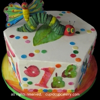 Very Hungry Caterpillar Inspired Cake Cake is buttercream finish. Details were painted on modelling chocolate with food colors. Caterpillar and butterfly are made of gumpaste....