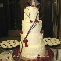 Tree Branch Wedding Cake  4 tier cake to serve 130. Red Velvet cake filled with alternating layers of raspberry and cheesecake swiss meringue buttercreams. Tree...