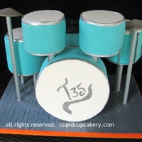 Drum Set Cake Birthday cakes assembled to look like a drum set or drum kit.