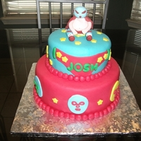 Nacho Libre Tiered cake in rolled fondant with gumpaste luchador