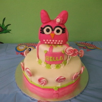 Owl Cake Tiered cake in rolled fonadant, owl made out of cereal treats