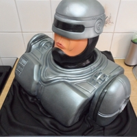Robocop Bust Cake Spray painted and hand carved belgian chocolate,madeira and coconut madeira cakes.