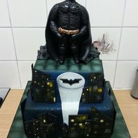 Batman Cake Two tiered, air brushed Madeira sponge cake with hand modelled Batman figure!