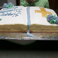 Bible Cake Bible cake made for brother in laws birthday. 9x13 cut with a cake leveler to give it a rounded look. Decorated with buttercream, Cross is...