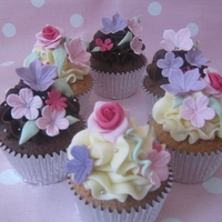 Pretty Flower Cupcakes Vanilla and filled chocolate fudge cupcakes decorated with handmade and edible decorations.
