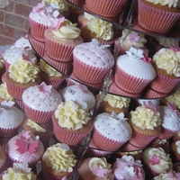 Wedding Cupcakes - Pink & White 120 cupcakes and giant cupcake top cake. Wedding theme was dusky pink and butterflies. Cupcakes are topped with buttercream swirls or...