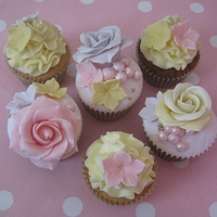 Romantic Pastel Vintage Style Cupcakes Pastel Vintage style cupcakes. Lace embossed fondant topped and buttercream swirled cupcakes decorated with handmade edible flowers and...