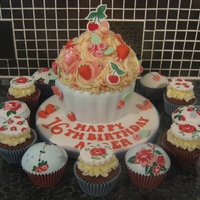 Cath Kidston Inspired Giant Cupcake & Cupcakes Vanilla Giant cupcake decorated with all handmade and edible decorations in a Cath Kidston style. Strawberries, cherries, butterflies and...