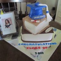 Graduation Cake This cake was exciting to make. I actually made two for two different families. The one you see was the blue cap, the other I made was with...