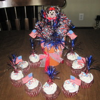Memorial Day Cupcakes And Lollicake Arrangement   Chocolate cupcakes filled with raspberry curd, whipped cream icing