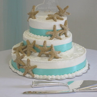 Sea Shell Wedding Cake This cake is a red velvet cake filled with cream cheese filling. Outside is buttercream.