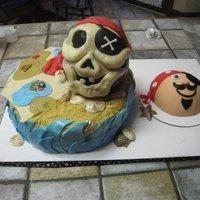 Pirate Cakes  These cakes were done for two brothers turning 4 and 1. One wanted a skull and the other needed a smash cake. Everything on the cake is...