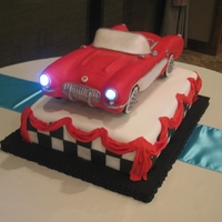 Classic Corvette Cake This was a grooms cake I made for a huge Corvette fan. Everything is edible but the lights.
