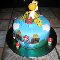 Yoshi Cake This cake was done for a little boy who loves Super Mario Bros especially Yoshi. The little cake was lite up.