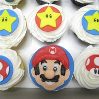 Super Mario Bros Cupcakes   These cupcakes were done for a Super Mario Brothers inthusiast. I tried to make all of his favorite characters.