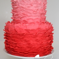 Ruffled Ombre Valentine's Cake Ruffles on the cake were made using the top half of a heart cutter.