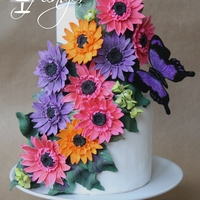"Gerber Daisy Butterfly Cake 6/4"" tiered coconut cake decorate with fondant gerber daisies and a butterfly"