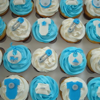 Blue & Grey Baby Shower Cupcakes Blue & Grey Baby Shower Cupcakes - the client didn't have a theme for the baby shower... just that they were using blue & grey...