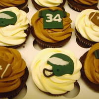 Philadelphia Eagles Cupcakes Chocolate Cupcakes with vailla or chocolate buttercream and custom made fondant toppers - all hand cut.