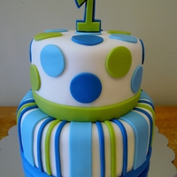 Stripes & Dots Boys 1St Birthday 2 tier vanilla cake with vanilla buttercream covered in rolled fondant with fondant decorations & topper
