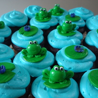 Froggie & Lily Pad Cupcakes Froggie Birthday Cupcakes!Chocolate cupcakes with vanilla creamcheese buttercream. Hand formed marshmallow fondant frogs & lily pads....