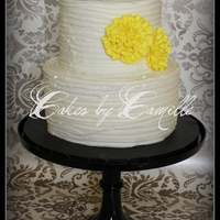 Yellow Ruffle Flowers   Yellow fondant ruffle flowers just pop on this textured buttercream cake.