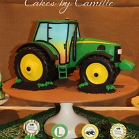 John Deere Sculpted 3-D Tractor This was a special treat for my son's 4th birthday. Triple chocolate fudge cake iced in chocolate ganache then covered in fondant.