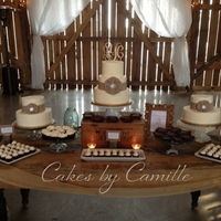 Rustic Elegance This rustic yet elegant dessert buffet included 3 tiered cakes, red velvet cupcake, strawberry mini cupcakes, cake pops, and brownies. Hand...