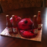 Crawfish Boil Birthday This is all buttercream, and pink cake inside, except the eyes are sugarpaste. The bottles are poured sugar.