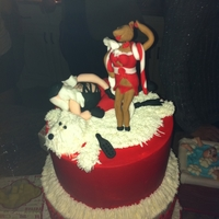 Naughty Santa All buttercream except Santa and the reindeer on top. For a naughty or nice party.