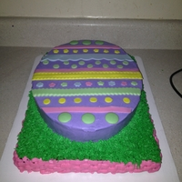 Easter Egg Cake   egg iced on butter cream- fondant accents