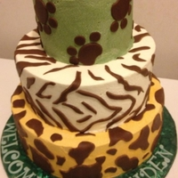 Jungle Themed Baby Shower Cake Tiered jungle themed cake with fondant accents.