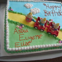 Triplets Birthday Cake  My daughter actually made this cake for her teacher! She made the babies and the wagon out of fondant and it is iced with whip topping :) I...