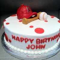 Angles Team Birthday Cake The hat is made out of RCT and covered with modeling chocolate, the others are just fondant.