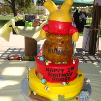 Winnie The Pooh Bithday Cake 1st stack cake I have done :) Pooh is made out of modeling chocolate & rct. the figures are of fondant/gumpaste.