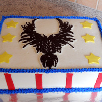 504Th Phoenix Cake Cake done for my husband's military company. Vanilla cake iced in vanilla BC. Stars and stripes done in satin ice fondant. Phoenix is...