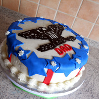 Colonel's Cake 10 inch round chocolate cakes iced in vanilla BC. Stripes and stars done in Satin Ice fondant. Colonel insignia done via FBCT. (First FBCT...