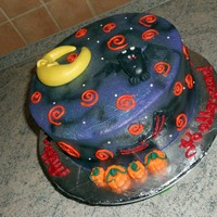 "Halloween Cake Vanilla cake (cake is colored orange and purple unfortunately its not shown in pics), iced in BC, airbrushed for a ""night sky""..."
